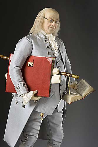 Ambassador Benjamin Franklin carries the red diplomatic portfolio.