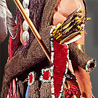 Left close up color image of Comanche Warrior, by George Stuart.