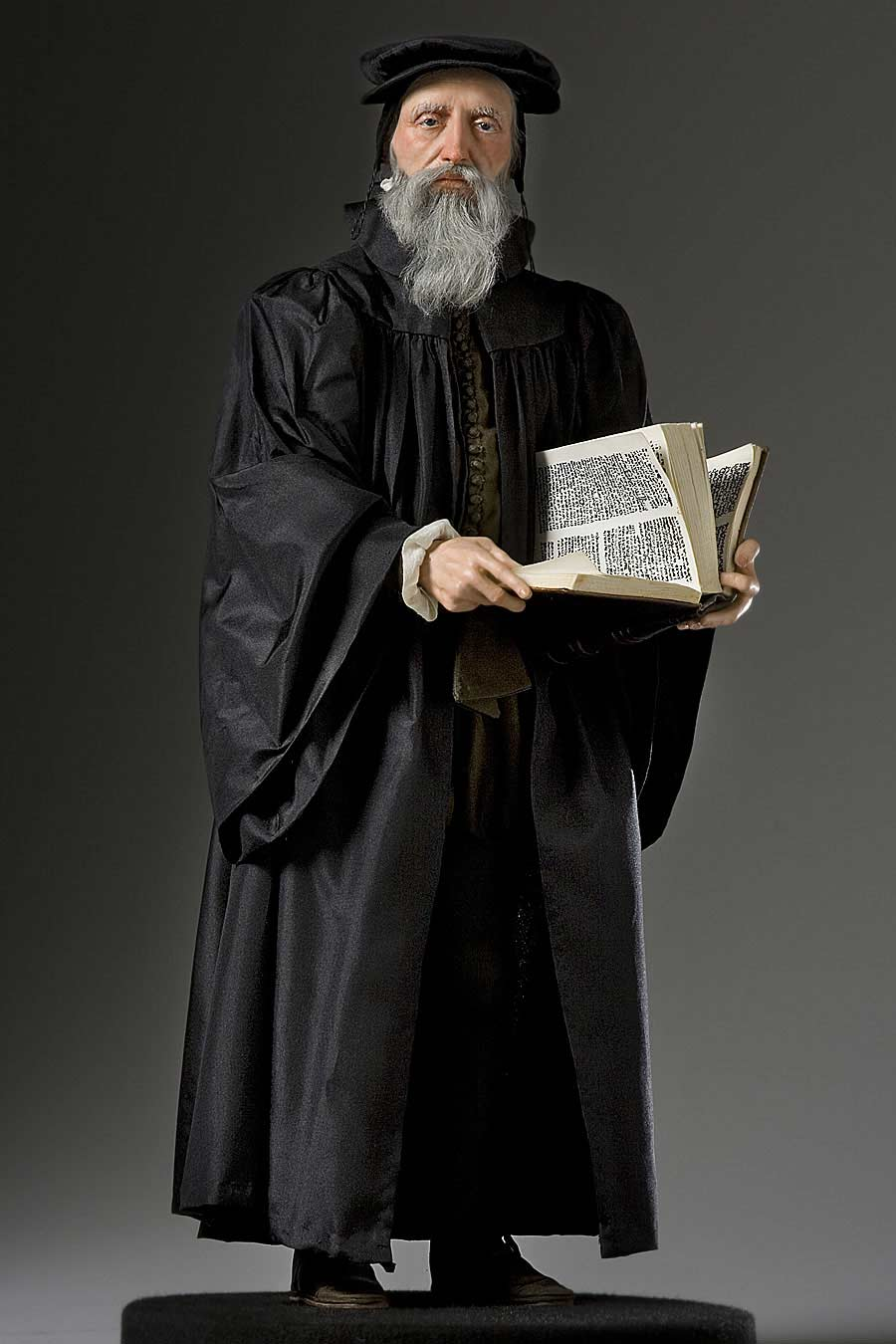 Full length color image of John Calvin aka.