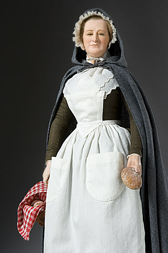 Martha Washington at Valley Forge)holding bread basket and loaf
