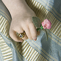 Archduchess Maria Antonia closeup of hand clutching flower
