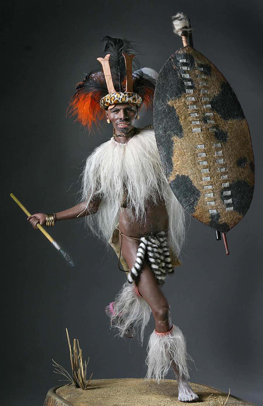 Full length color image of Zulu Warrior, by George Stuart.